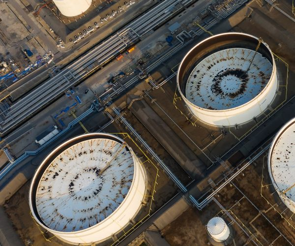Aerial view or top view oil terminal is industrial facility for storage of oil and petrochemical. oil manufacturing products ready for transport and business transportation.
