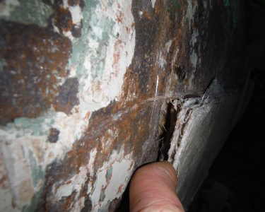 Corrosion Behind Poorly Adhered Fiberglass Coating